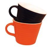 2 керамических чашки голубой и оранжевой Стоковое Фото