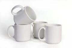 4 керамических чашки изолированной на белой предпосылке Стоковое Изображение RF