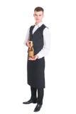 Кельнер с бутылкой шампанского Стоковое Изображение