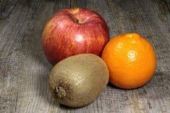 Киви, яблоко и апельсин Стоковые Фото