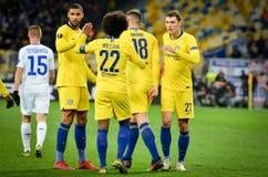 Киев, УКРАИНА - 14-ое марта 2019: Футболист и Willian Челси празднуют цель вести счет во время матча лиги Европы UEFA стоковые изображения