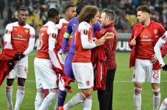 КИЕВ, УКРАИНА - 29-ое ноября 2018: Футболист арсенала FC (Англии) во время матча лиги Европы UEFA между Vorskla стоковое фото