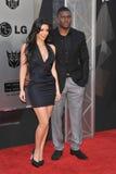 Ким Kardashian, Reggie Bush стоковая фотография