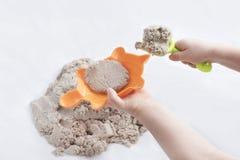Кинетические песок и игрушки Стоковая Фотография