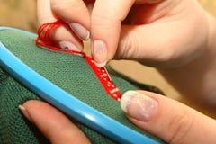 кинжал вышивает женщине Стоковое фото RF
