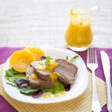 Кипеть язык говядины с оранжевым соусом Стоковые Изображения RF