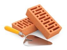 Кирпичи и лопатка на белой предпосылке Стоковая Фотография RF