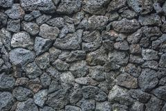 Кирпичи предпосылки текстуры вулкана каменные в стене Стоковая Фотография RF