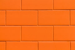 Кирпичная стена апельсина крупного плана Стоковые Фото