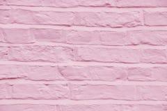 Кирпичная стена покрасила довольно розовую предпосылку цвета Стоковые Изображения RF