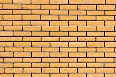 Кирпичная стена Кирпичная стена покрашенная в желтом цвете Стоковые Изображения RF