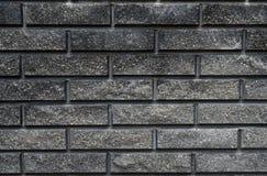 кирпичная стена предпосылки черная Стоковые Фото