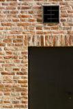 Кирпичная стена с дверями Стоковое Изображение