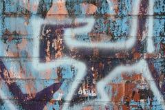 Кирпичная стена с граффити Стоковое Фото
