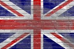 Кирпичная стена с флагом Великобритании Стоковая Фотография