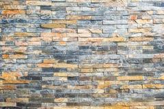 Кирпичная стена, текстура покрашенного milti каменного крупного плана блоков стоковые изображения