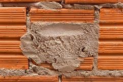 Кирпич и миномет в unplastered стене Стоковая Фотография RF