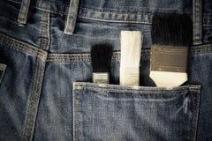 кисти в карманн джинсов Стоковые Изображения RF