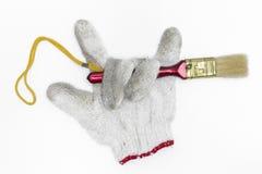 Кисти и перчатки на белой предпосылке Стоковая Фотография RF