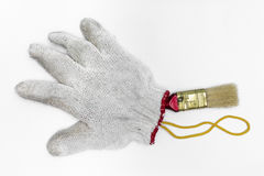 Кисти и перчатки на белой предпосылке Стоковая Фотография