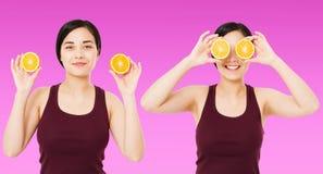 Китаец коллажа счастливый, азиатская женщина, девушка держа части апельсинов изолированных на пурпурной предпосылке, концепции за стоковые фото