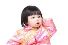 Китайская голова царапины ребёнка стоковая фотография