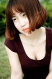 Китайская девушка в саде Стоковое фото RF