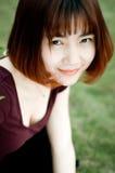 Китайская девушка в саде Стоковая Фотография