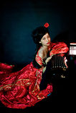 Китайская девушка одетая в классическом платье Стоковые Фотографии RF