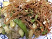 Китайская еда на плите в ресторане Стоковые Фото