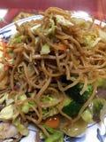 Китайская еда на плите в ресторане Стоковые Фотографии RF