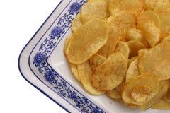 китайская еда обломоки изолировали белизну картошки Стоковое Фото