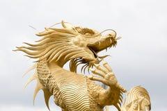 Китайская золотая статуя стороны дракона Стоковое фото RF