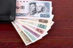 Китайские деньги в черном бумажнике стоковые фото