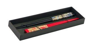 Китайские деревянные инструменты ручки еды в коробке на белизне Стоковая Фотография