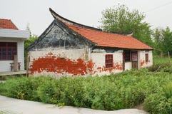 Китайские дома в деревне и сельскохозяйственное угодье Стоковое Фото