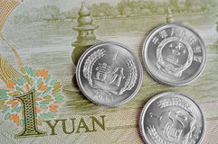 Китайские примечания и монетки Стоковое Фото