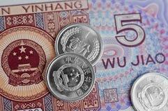 Китайские примечания и монетки Стоковые Изображения