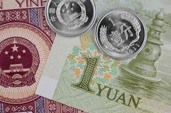 Китайские примечания и монетки Стоковое Изображение