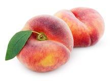 Китайские плоские персики донута с лист на белизне Стоковые Изображения