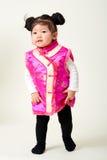Китайский ребёнок в обмундировании Нового Года традиционного китайския Стоковое Фото