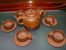 Китайский чайник глины с чашками Стоковые Фото