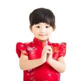 китайское счастливое Новый Год маленькая девочка с жестом поздравлению Стоковые Изображения