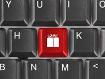 Клавиатура компьютера с ключом подарка Стоковое фото RF