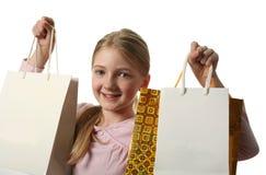 кладет девушку в мешки держа милую покупку Стоковое Изображение