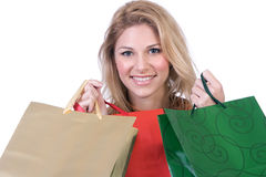 кладет женскую покупку в мешки удерживания Стоковые Фотографии RF