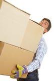 кладет картон в коробку огромный Стоковое фото RF