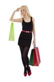 кладет красивейшую белокурую женщину в мешки покупкы удерживания Стоковое Фото