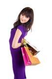 кладет красивейшую shoping женщину в мешки Стоковое Фото