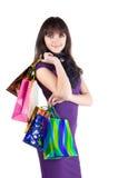 кладет красивейшую shoping женщину в мешки Стоковое Изображение